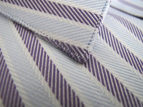 Perfect for business shirts, the Loro Piana twill, featured here in Purple and Blue Herringbone, holds great shape and is a perfect compliment to a tailored jacket.